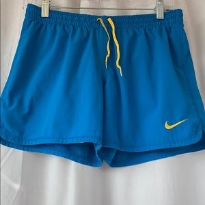 Neon blue athletic shorts with yellow spandex